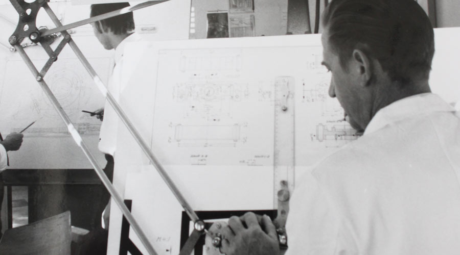 Conscientious planning and design at the supplier of sensor technology EBE Elektro-Bau-Elemente GmbH.The picture shows the work of the designers at drawing boards in the earlier decades of the company history